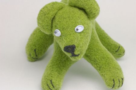 Small green teddy on white