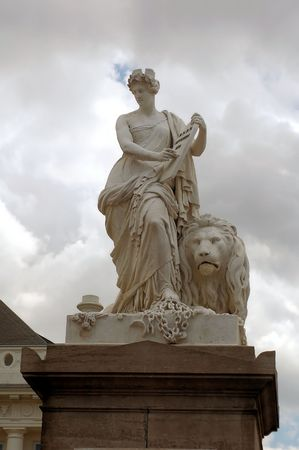 statue of adult woman with lion