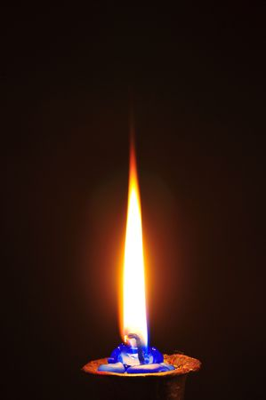 Flaming candle in darkness Stock Photo - 2413494