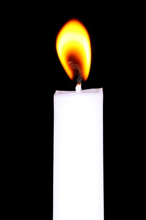 Flaming candle in darkness Stock Photo