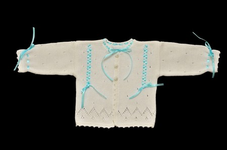 Small hand knitted jacket for babies