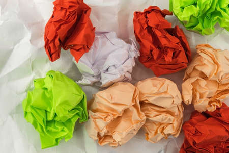 View from above on the colored dense crumpled paper, which lies on the white slightly crumpled paper Foto de archivo