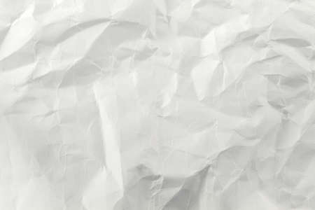 A crumpled sheet of white paper close-up fills the entire picture Foto de archivo