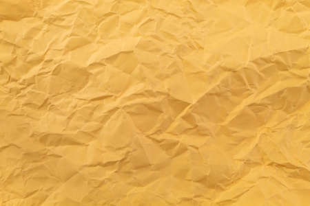 Texture and background with irregularities of lightly crumpled orange paper