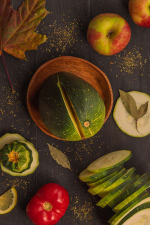 Top view of fresh vegetables and fruits that lie on a black background