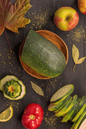 Fresh and healthy vegetables and fruits lie on a black wooden background 版權商用圖片