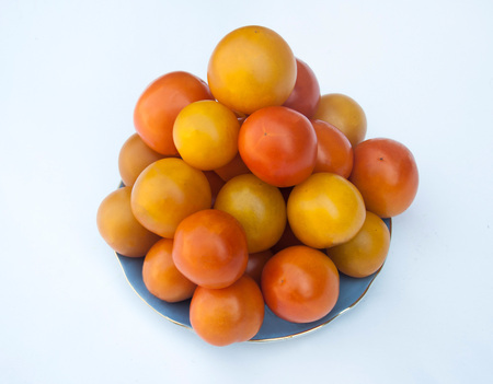sorts: Different sorts of tomatoes served on a white dish, with white background Stock Photo