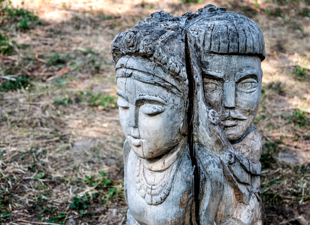 genie woman: The wooden figure of a man and woman in the park, Ukraine Stock Photo