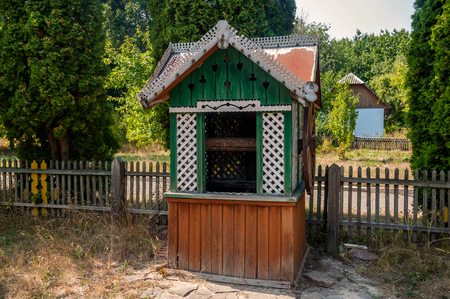 wheel house: old wooden water well house with a large wheel, Kiev, Ukraine