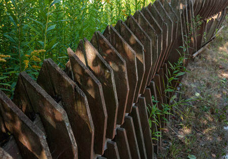 palisade: Old wooden fence in the village, Kiev, Ukraine Stock Photo