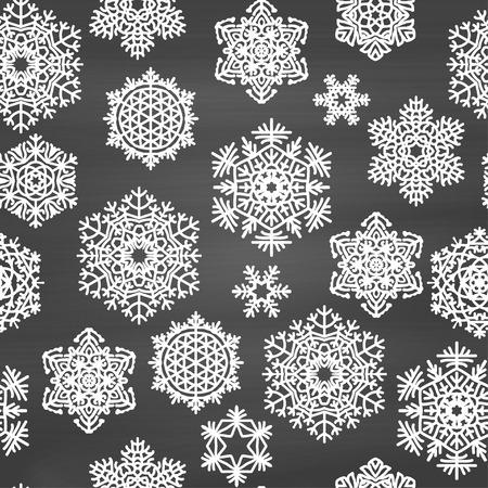 冬の手でシームレスなパターンは、黒板の背景に雪を描画します。ベクトルの図。