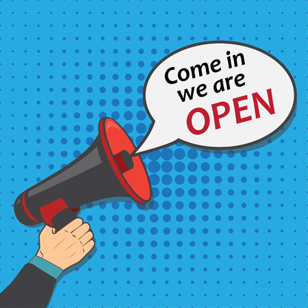 come in: Hand holding megaphone with bubble speech come in we are open