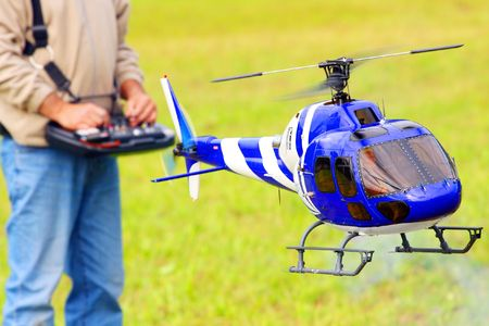 controlled: Piloting Radio controlled helicopter  Stock Photo