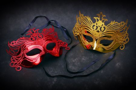 Decorated mask for masquerade on red velvet. Great for halloween brochures and advertisements. Unauthorized homemade paper product.  photo
