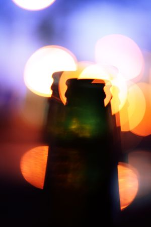 Bottle with multiple shapes and lights in background photo