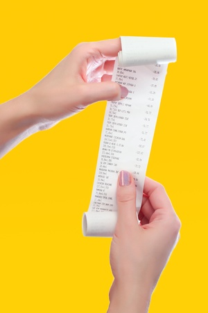 receipts: woman holds in her hands roll of paper with printed receipt