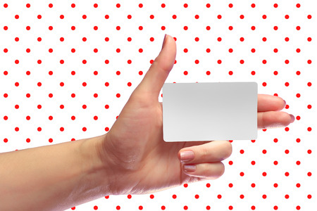 transponder: Left Female Hand Hold Blank White Card Mockup. Prepaid SIM Cellular Plastic Transponder NFC  Smart Tag Id EPC RFID Call-card Mock Up Template With Rounded Corners. Front Display of  Credit Namecard or Cell Operator Transport Identification Metro Ticket. N Stock Photo