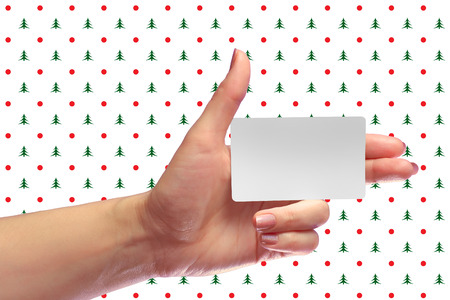 Left Female Hand Hold Blank White Card Mockup. Prepaid SIM Cellular Plastic Transponder NFC  Smart Tag Id EPC RFID Call-card Mock Up Template With Rounded Corners. Front Display of  Credit Namecard or Cell Operator Transport Identification Metro Ticket. N Stock Photo