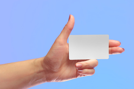 transponder: Left Female Hand Hold Blank White Card Mockup. Prepaid Plastic NFC Id EPC RFID Call-card Mock Up Template With Rounded Corners. Front Display of Credit Namecard or Transport Identification Metro Ticket. Business Branding. Brand-book Design Draft. Thumb Up