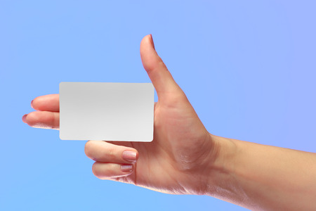 transponder: Right Female Hand Hold Blank White Card Mockup. Prepaid Plastic Transponder NFC Smart Tag Id  EPC RFID Call-card Mock Up Template With Rounded Corners. Front Display of Credit Namecard  or Transport Identification Metro Ticket. Business Branding. Brand-bo Stock Photo