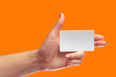 Left Female Hand Hold Blank White Card Mockup. Prepaid Plastic NFC Id EPC RFID Call-card Mock Up Template With Rounded Corners. Front Display of Credit Namecard or Transport Identification Metro Ticket. Business Branding. Brand-book Design Draft. Thumb Up