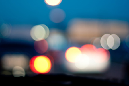 metropolis image: Intentionally Blurred Background. Heavy Traffic on Evening Road. Bokeh. Car Headlights on Congested City Highway at Dusk. Image May Be Used in Article About Transportation Problem in Metropolis. Stock Photo