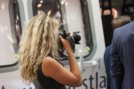 MOSCOW, RUSSIA - MAY 23, 2015: Women photographer at the 8th International Helicopter Industry Exhibition HeliRussia 2015 in Crocus Expo.