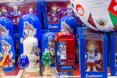 MOSCOW, RUSSIA - APRIL 30, 2018: Zabivaka is the official mascot of the 2018 FIFA World Cup mundial, which will be held in Russia. Souvenir shop shelf. Representing an anthropomorphic wolf doll.