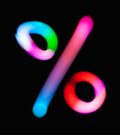 Glowing % symbol. Percent, number or ratio. Dark background. Abstract night light painting. Creative artistic colorful bokeh.  Build design for sale discount, book cover, CD, party poster or post card