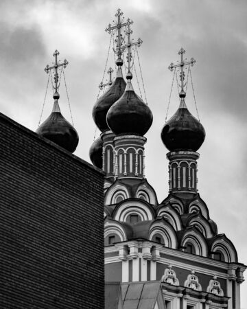 Domes of Church of St. Nicholas on Bolvanovka. In 1632, wooden Church of St. Nicholas was built in Bolvanovka. In 1702-1712 it was replaced by stone temple. Black and white shot Banco de Imagens