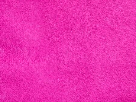Background with leather texture. Pink piece of natural tanned calfskin painted and treated with fuchsin paint. Lots of detail, frontal shot with macro lens. Copyspace for border or frame