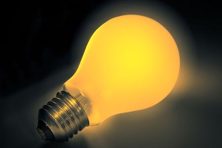Yellow lightbulb illuminated on a dark background with clipping path Stock Photo - 287949