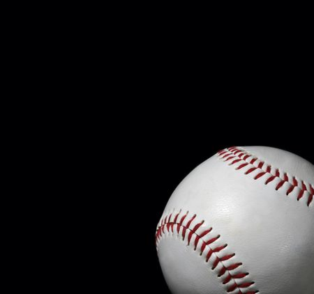 close-up of baseball on black background with copy space photo