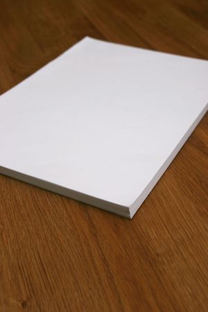 wooden insert: Blank notepad on a wooden desk. (Insert your own message) Stock Photo