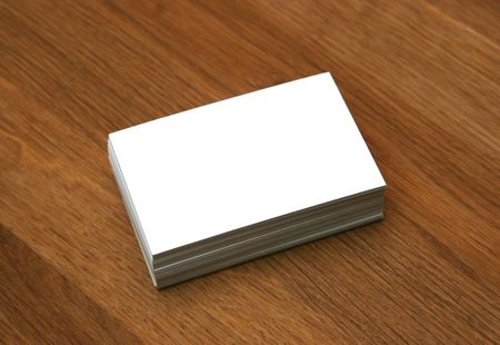 wooden insert: Blank business cards stacked up on a desk - insert your own design Stock Photo