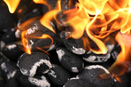 broil: Charcoals engulfed in flames Stock Photo