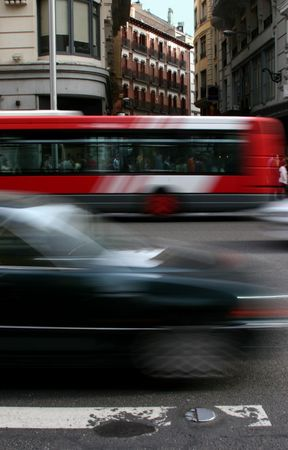 Motion blurred cars driving through city Stock Photo