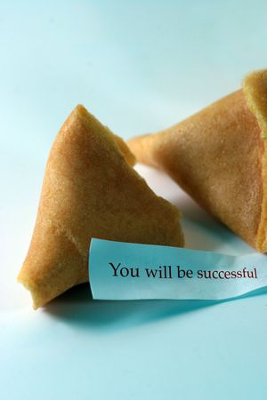 Open fortune cookie with the message you will be successful photo