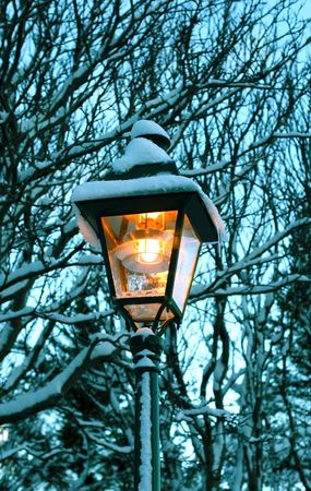 public spirit: Antique streetlight with fresh snowfall from a blizzard Stock Photo