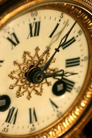 counterclockwise: Macro detail of an old fashioned clock Stock Photo