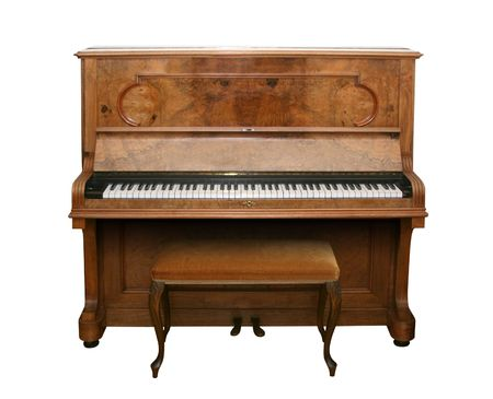 Old fashioned piano isolated on white with  Stock Photo