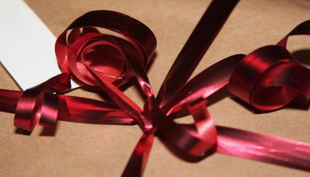 filled out: close up of a gift with a blank card to be filled out by you