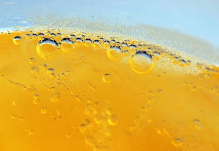 quenching: Macro shot of bubbles in yellow liquid