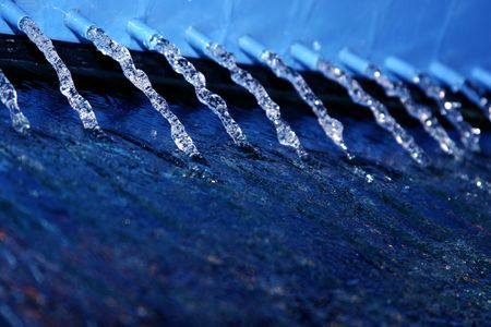 Water flowing from several pipes photo
