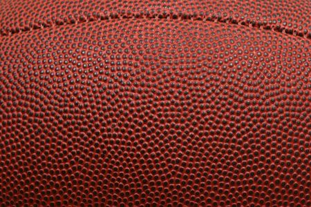 playoff: Macro of football texture with seam