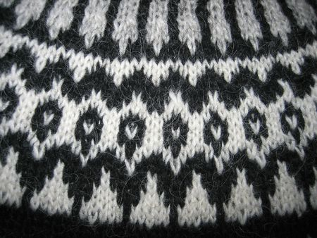 Macro of a handmade wool sweater with old pattern photo