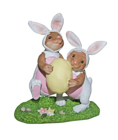 bunnie: Clay easter bunnie figures carrying an easter egg - image contains a clipping path Stock Photo