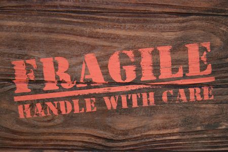 Real photo of wooden box stamped with Fragile handle with care Stock Photo - 371555