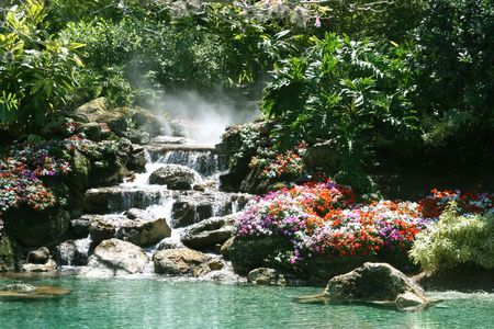 Waterfall in a beautiful tropical setting photo