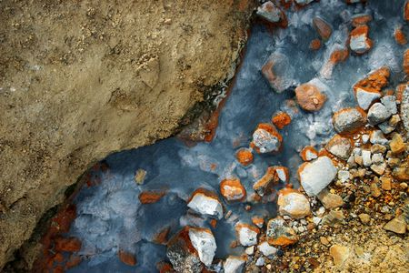 mud and snow: Amazing colors in a geothermal creek in Iceland - The colors come from minerals in the boiling hot water